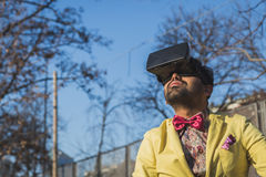 Indian handsome man wearing virtual reality headset Royalty Free Stock Image
