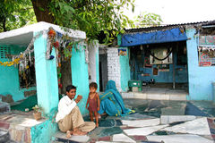 Indian happy young man with his family having tea or coffee, outside of there home. Stock Photo