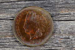 Indian Head Cent in uncirculated condition on old wood Royalty Free Stock Images