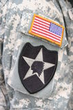 Indian Head and flag patch on army soldier uniform. Indian Head patch of the 2nd Infantry Division of the US Army and USA flag on the sleeve of a returning Iraq stock photos