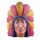 Indian head statue isolated. Indian head carved out of wood Royalty Free Stock Photo