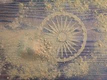 Indian henna powder forms Ashoka Chakra wheel. On the textured wooden board Stock Photos