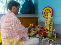 Indian Hindu Brahmin priest worshiping Goddess saraswati. stock photo