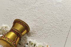 Indian Hindu Bride entering groom's home after wedding by pushing pot filled with rice with her foot. Stock Photography