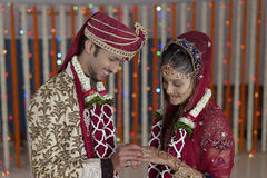Indian Hindu Bride & Groom a happy smiling couple exchanging wedding ring. Stock Photography