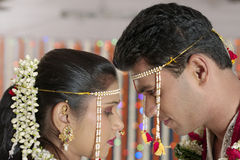 Indian Hindu Bride and Groom looking at each other in maharashtra wedding. Royalty Free Stock Image