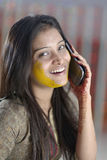 Indian Hindu Bride with turmeric paste on face. Royalty Free Stock Images
