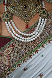 Indian Hindu Brides sari, necklace jewelry and close up of chest royalty free stock photos