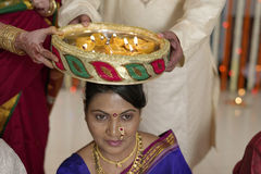 Indian Hindu symbolic ritual in wedding. Symbolic ritual in Indian Hindu maharashtra wedding of taking responsibility of Bride by her mother in law Royalty Free Stock Photo