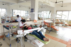 Indian Hospital. Dentist cleaning the patient's teeth at hospital Stock Photo