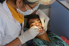 Indian Hospital. Dentist cleaning the patient's teeth at hospital Royalty Free Stock Photos