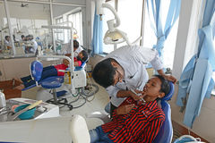 Indian Hospital. Dentist cleaning the patient's teeth at hospital Stock Photography