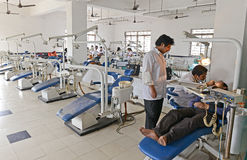 Indian Hospital. Dentist cleaning the patient's teeth at hospital Royalty Free Stock Photography