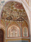 Indian interior. Painting of ceilings of harem. India. Jaipur. Amber fort Stock Image