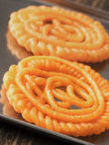 Indian jalebi sweets. Close up of indian jalebi sweets stock image