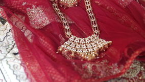Indian jewelry indian cloths. Indian jewelry lays on indian cloths on the wedding between european stock video footage
