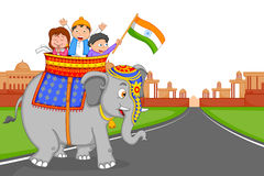 Indian kid hoisting flag of India Royalty Free Stock Photography