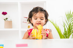 Indian kid playing with toys royalty free stock image