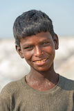 Indian kid on salt farm Stock Image