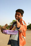 Indian kid selling on streets Royalty Free Stock Photos