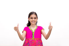 Indian kid showing two hands thumbs up Royalty Free Stock Image