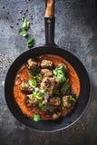 Indian kofta Meatball with Curry sauce. On dark background stock photos