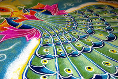 Indian kolam with peacock pattern. Colorful Indian kolam with peacock pattern Stock Photos