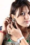 Indian kundan jewellery. Indian girl wearing traditional kundan jewellery stock photography