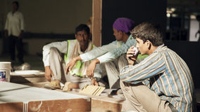 Indian labours on tea break during work Stock Photos