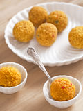Indian laddoo sweets. Close up of indian laddoo sweets stock photography