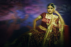 Indian lady in bridal wear royalty free stock photography
