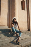 Indian lady in casual summer outfit against ancient building. Royalty Free Stock Photography