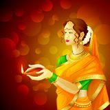 Indian lady with Diwali diya Royalty Free Stock Images