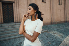 Indian lady in dress against ancient building with thoughtful look Royalty Free Stock Images