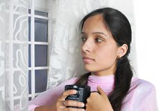Indian lady enjoying coffee. Stock Photo