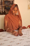 Indian lady hand printing fabric. Rajasthan, India. Stock Images