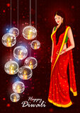 Indian lady for Happy Diwali holiday India background Stock Image