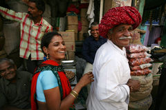Indian lady and man with smiling faces in market Royalty Free Stock Photo
