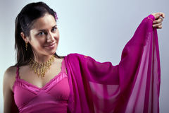 Indian lady with raised hand Royalty Free Stock Photo