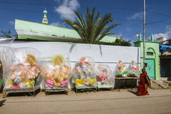 Indian lady in saree walking in front of Ganesh Idols Stock Photography
