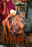 An indian lady  washing in the  ganges river Royalty Free Stock Photo