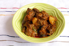 Indian lamb curry, spicy ethnic food. A dish of aromatic Indian spicy lamb or mutton curry, a well known dish cooked with indian spices.  Stewed with potato and Stock Photo