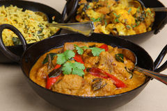 Indian Lamb Korma Curry & Rice. Lamb korma Indian curry with pilau rice and aloo gobi vegetable curry Stock Image