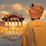 Indian landscape. Poor man in the north of India during the sunset Stock Image