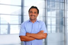 Indian latin businessman blue shirt modern office Royalty Free Stock Photo
