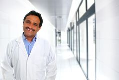 Indian latin doctor expertise smiling in hospital. Corridor stock images