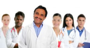 Indian latin expertise doctor multi ethnic doctors. Nurse in background stock image
