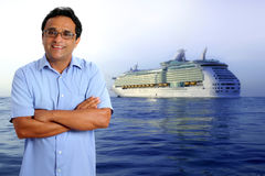 Indian latin tourist man cruise vacation ship boat. Indian latin tourist man in his sea vacation with a cruise in the background royalty free stock image