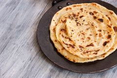Indian layered Paratha flat bread. Indian layered Paratha roti kerala porotta Stock Photo