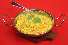 Indian Lemon Pilau Rice. In a stainless steel serving dish Stock Image